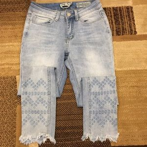Distressed hem ankle jeans